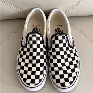 Checkerboard slip on vans
